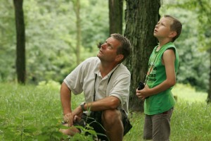 father_and_son_enjoy_a_leisurely_afternoon_of_birdwatching